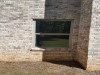 Atlanta Builders and Remodeling installed windows into a brick basement - After