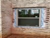 Atlanta Builders and Remodeling installed windows into a brick basement - During